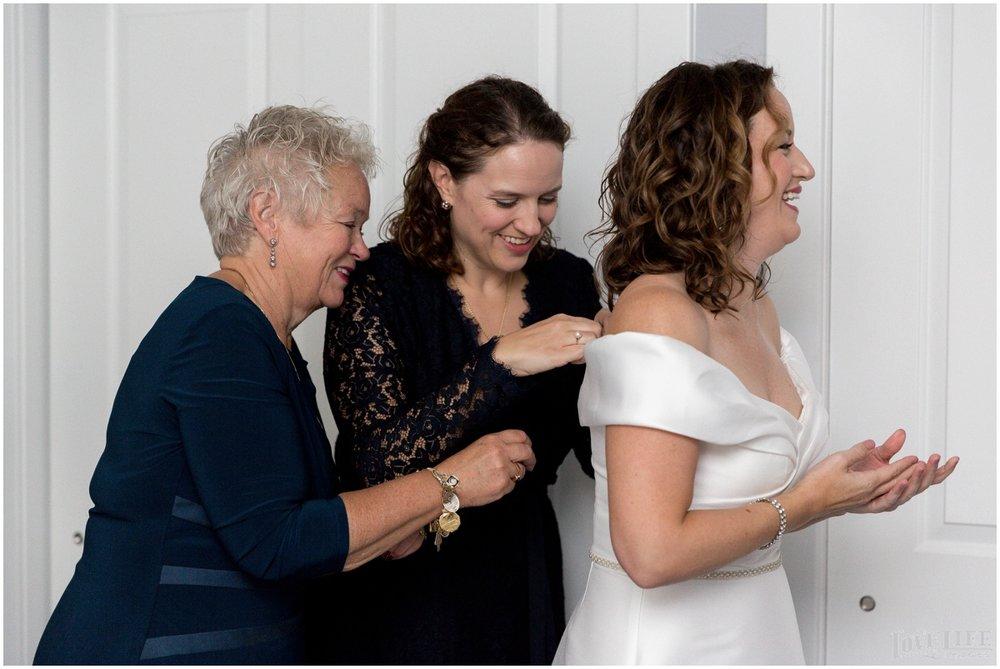 Anxo Cidery DC Wedding bride putting on dress.jpg