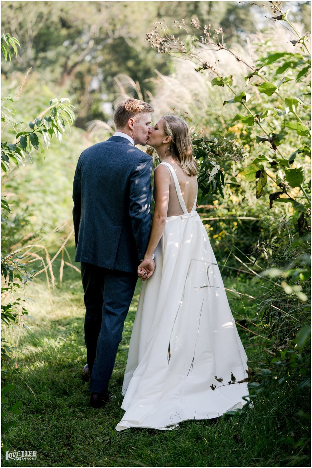 River Farm Wedding bride groom kissing.jpg
