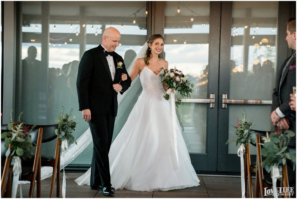 District Winery DC Wedding bride coming down aisle with father.jpg