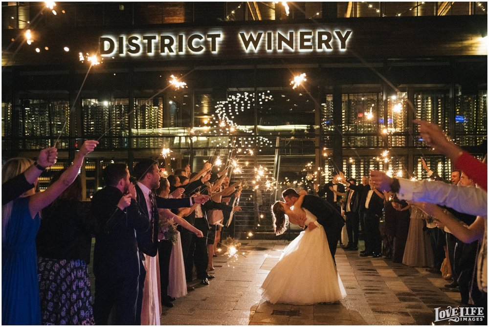 District Winery DC Wedding sparkler exit kiss.jpg