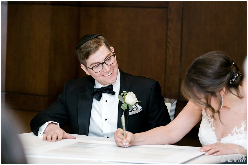 Fairmont DC Wedding bride signing ketubah.jpg