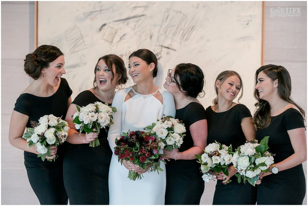 Winter District Winery Wedding bride laughing with bridesmaids.JPG