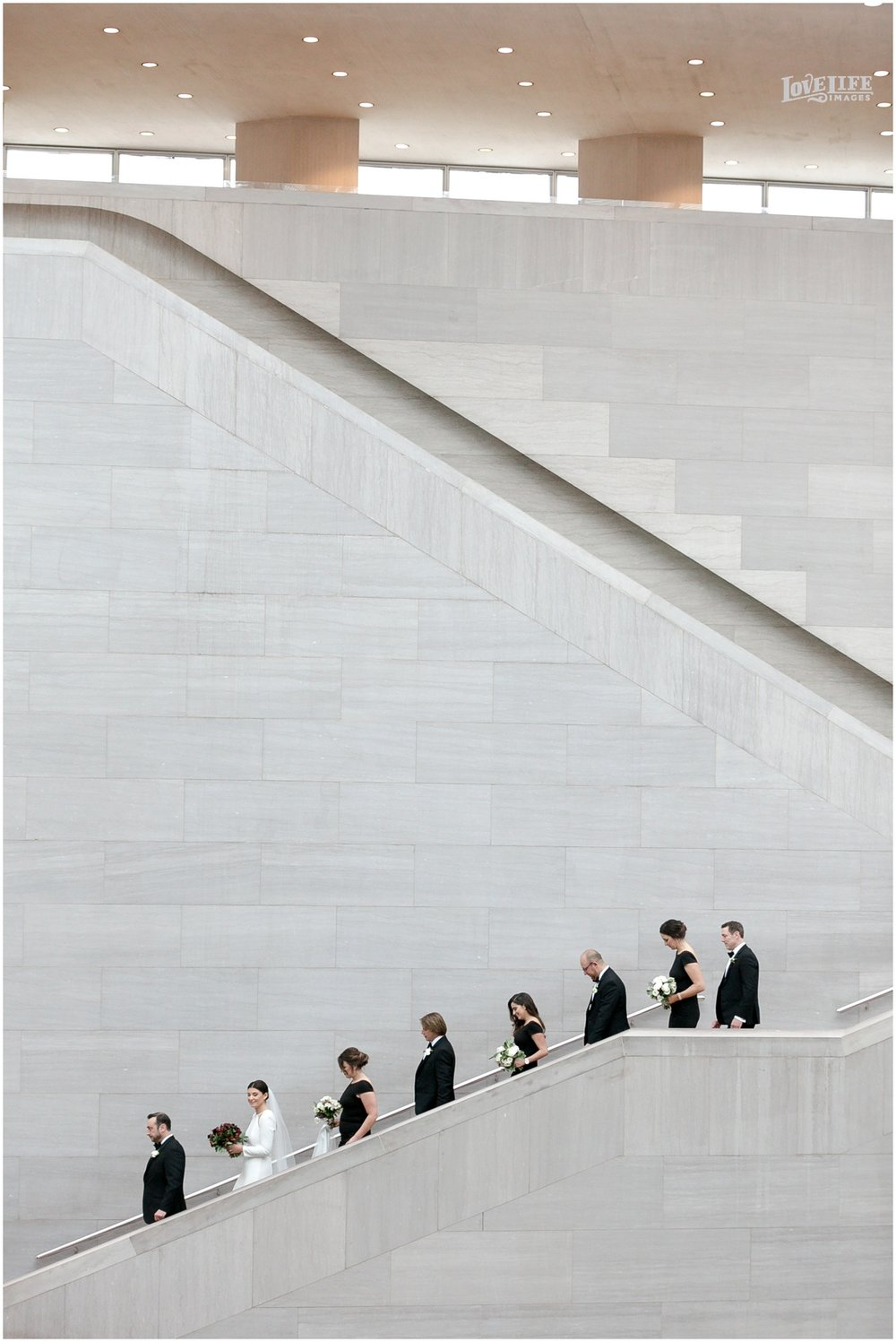 Winter District Winery Wedding art museum stairs portrait.JPG