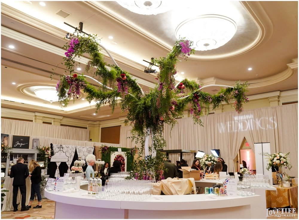 Nature by Design provided the florals for this statement tree at the main ballroom bar, built by BD3 Design.