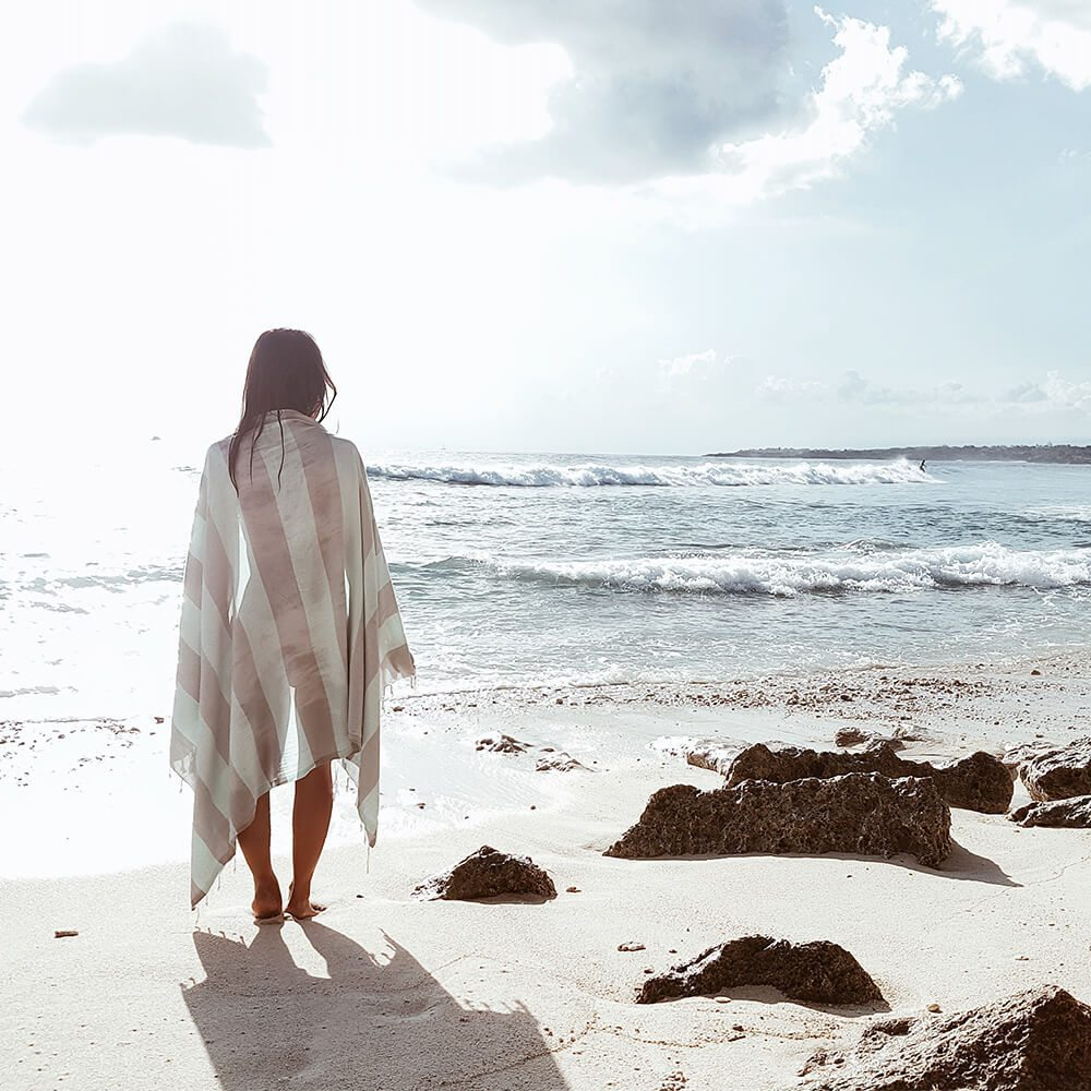 LUALOHA-Turkish-Towel-Buddhaful-Light-Grey-Light-Mint-walking-at-the-beach.jpg