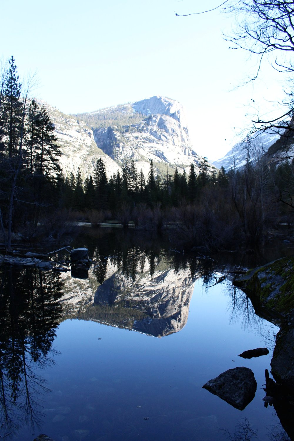 Mirror Lake . This spot is probably tied for first with Tunnel View as the most beautiful place I've seen in Yosemite. It's so peaceful and, for lack of a better word, reflective. Can you spot tiny Grace and Casper on the left side of the photo below?