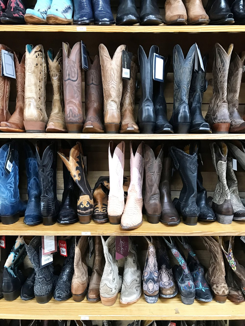 In another life, if I were Texan, those pink boots in the middle would be mine.