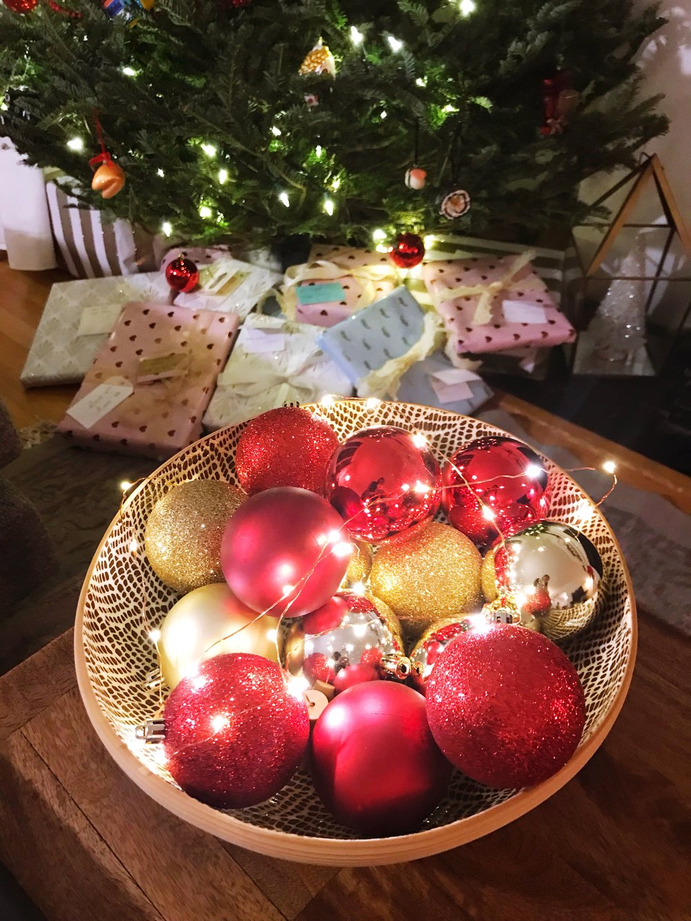 This bowl of ornaments has a few leftover fairy light strands from  our wedding exit  in it! It's so cozy and festive to me to turn on the lights at night.
