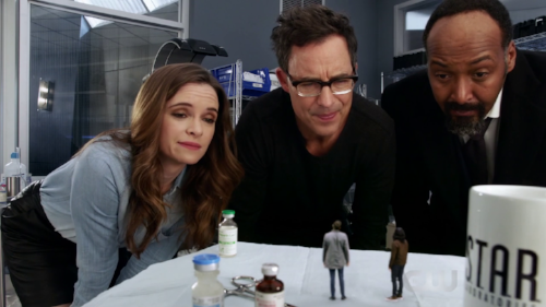 Caitlin,_Harry,_and_Joe_look_down_at_miniaturized_Cisco_and_Ralph.png