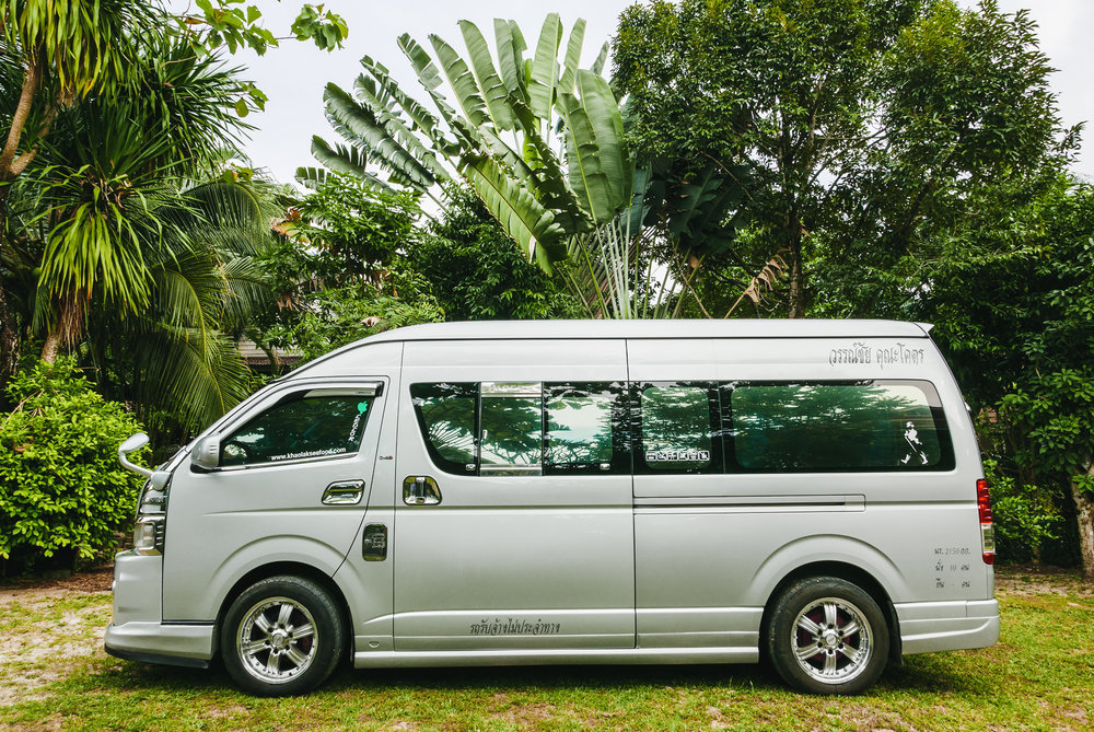 AIRPORT PICKUP SERVICE - We will pick you up from Phuket Airport on your arrival date and - if you wish - we also bring you back to the airport on your departure.Our experienced and safe driver will welcome you at the airport with an air-conditioned bus and a cold water or soda while you relax in the back. Just book your personal pickup along with your rooms and enjoy a hasslefree journey when you arrive. Click here to book your pickup