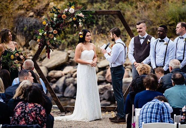 Throwing it back to one of our fall weddings 🍂  Planning Raven and Travis's wedding was such a delight! This beautiful fall wedding captured the bohemian energy through the vibrant sage and burgundy colors. And check out that amazing ceremony arch!  #RavenAndTravisWedding  Photographer: J.M Gant Photography Venue: @mishawakaampitheatre Catering: @juliyjuanskitchen DJ: Salazar Productions Florist: @laceandlilies  Transportation: Biodiesel for Bands Planning: @Mountainside Events  Rentals: @Flexxproductions  #mountainsideevents #mountainwedding #mishwedding #mishawakawedding #mishawaka #themish #poudrecanyon #fortcollins #coloradoevent #coloradowedding #fallwedding #weddingcoordinator #cowedding #weddingideas #weddingdiy
