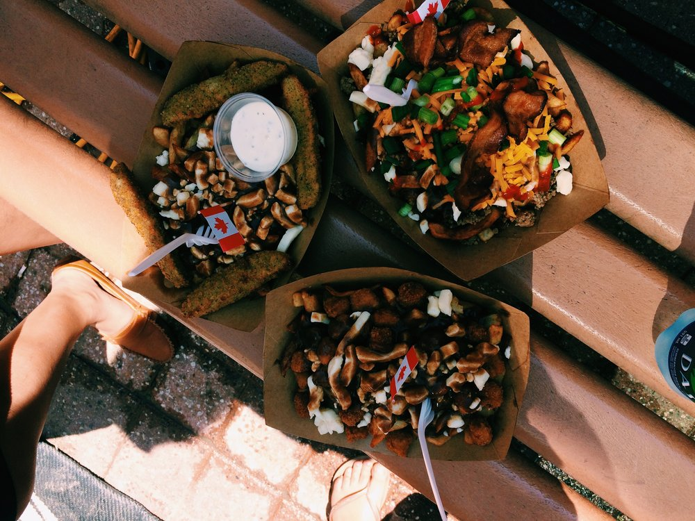 From top left: Fried pickle poutine, double bacon cheeseburger poutine Bottom centre: popcorn chicken poutine