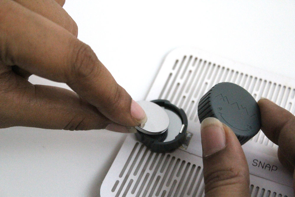 Power  Diah with 2 Coin Cell Batteries. Place the light flat on a surface, twist the cap to an unlock position and lift the lid to replace batteries.