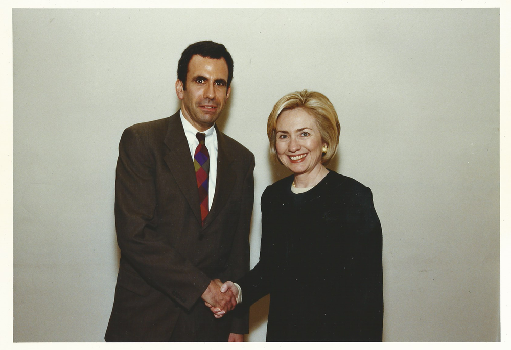 Storyteller George Perlov with U.S. Secretary of State, Presidential nominee Hilary Rodham Clinton.