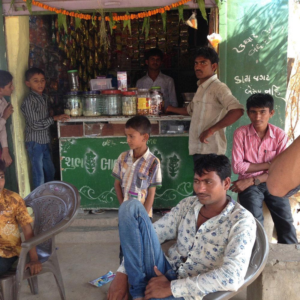 Pimps outside the village shop, Wadia village, Gujarat, India