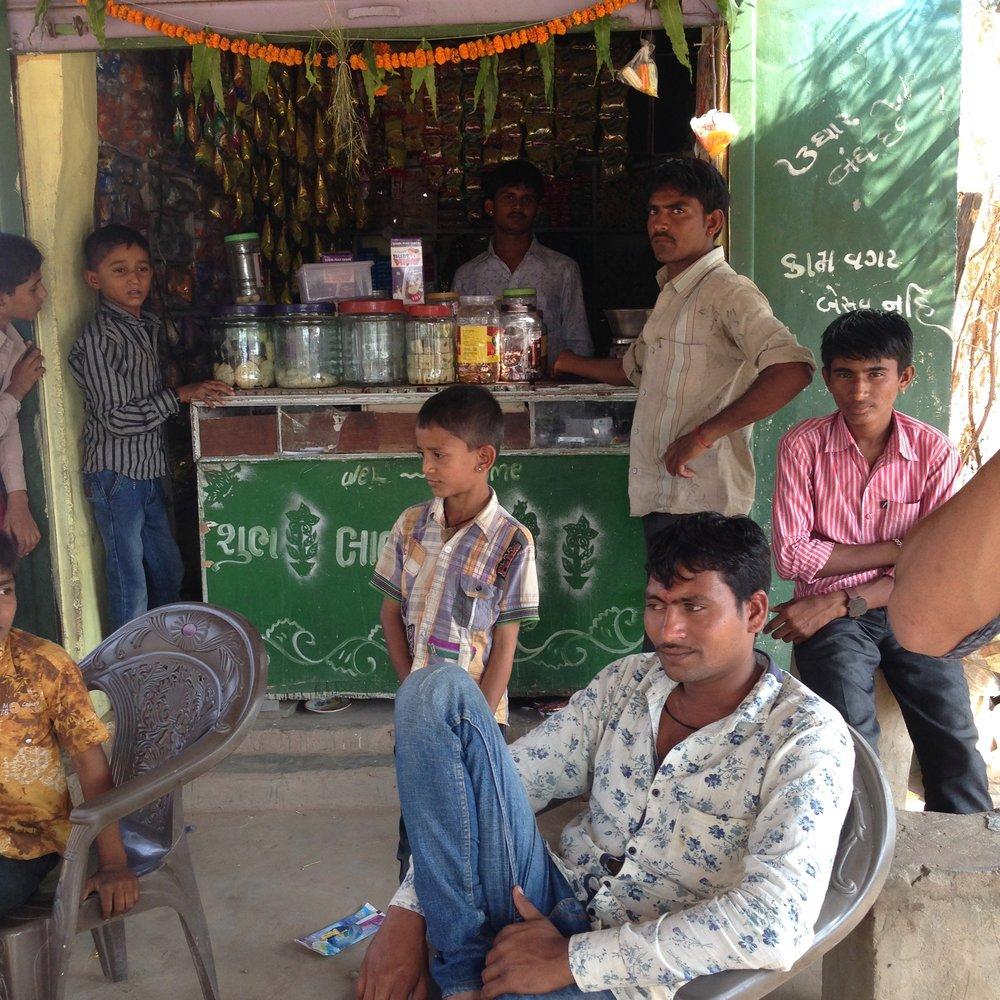 Pimps outside the village shop, Wadia, Gujarat, India