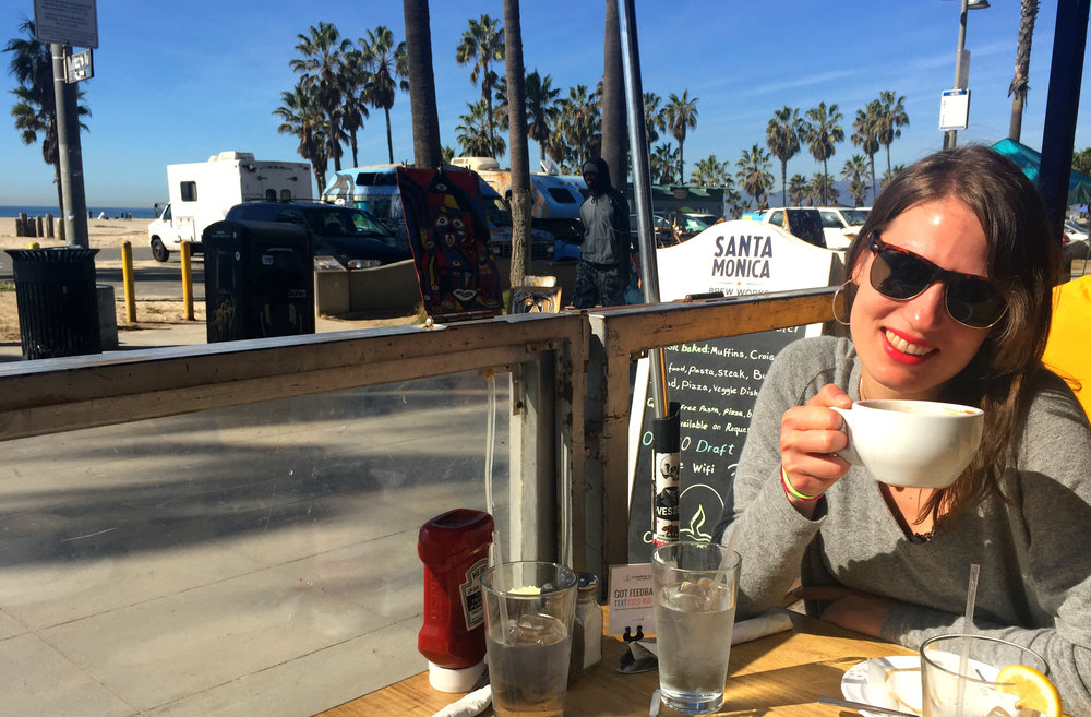 Drinking coffee at the Candle Cafe on the Venice Beach Boardwalk.