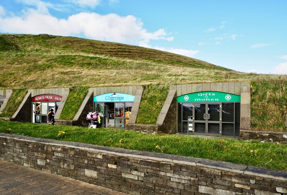 The eco-friendly, grass roofed Cliffs of Moher visitor center on top of the cliffs.