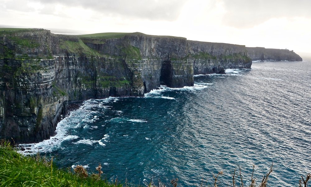 The legend about the cliffs is that there was once a large river. 'The river flowed down bringing mud and sand with ... and eventually formed the rock layers.' (Cliffs of Moher visitor center)
