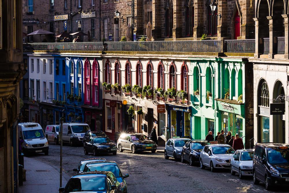 Colourful sunlit shops along Victoria Street, Edinburgh, Scotland.jpg