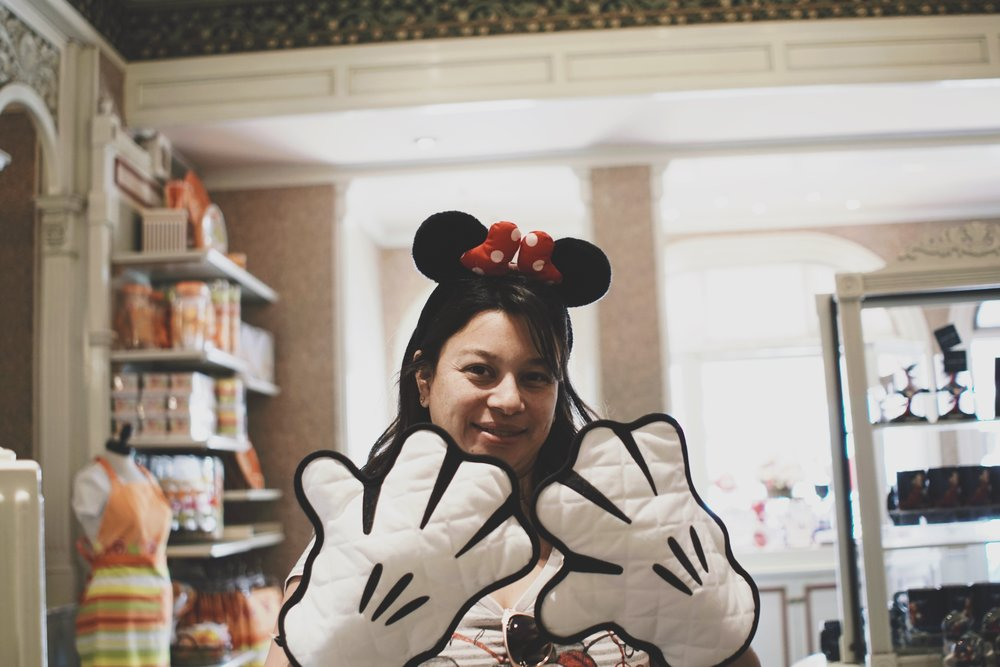 And trying on Mickey oven mittens.
