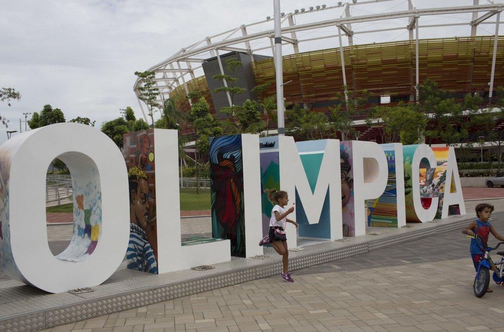 Some children use an Olympic monument as a playground |  AP