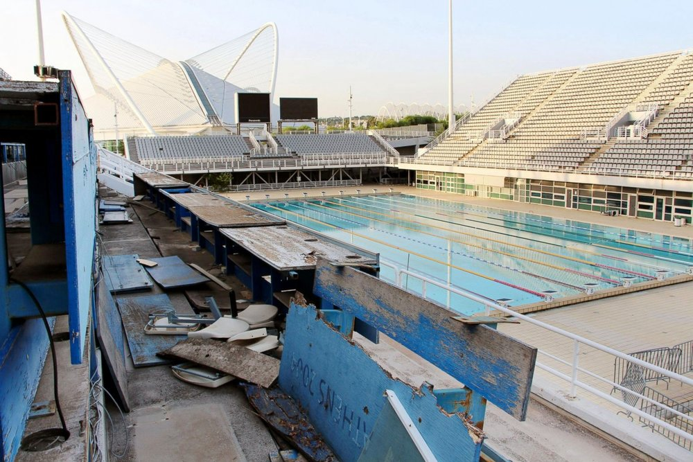 Seats for reporters at the main swimming pool for the 2004 Summer Olympic Games in Athens remain desolate | Kyodo News/Newscom