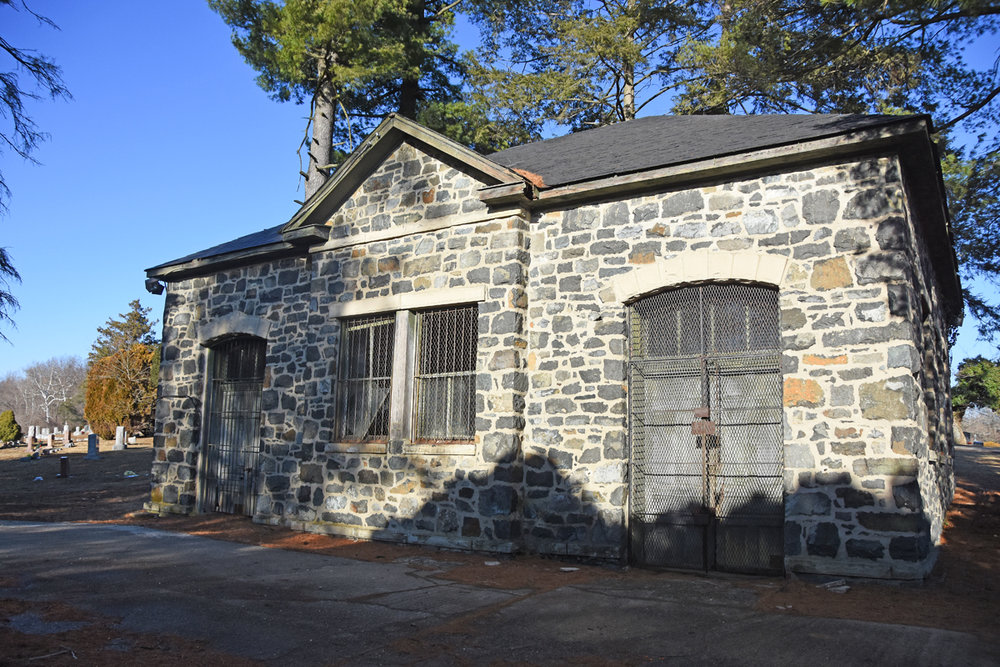 Woodlawn Cemetery still uses the only remaining building from the Powhatan Manufacturing Company as a storage shed.