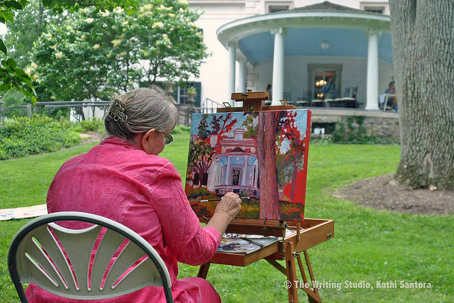 An En Plein Air artist painting the mansion on a summer day