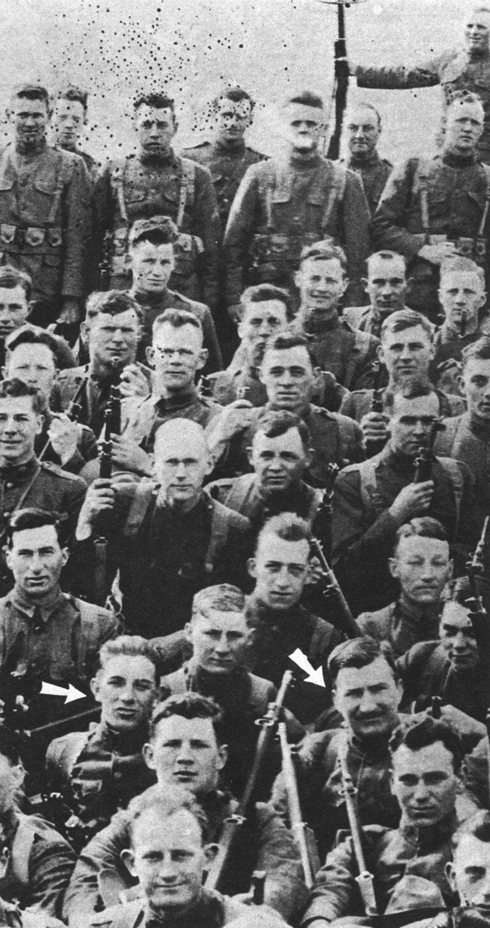 Henry Gunther with fellow soldiers. He is pictured at the right arrow.