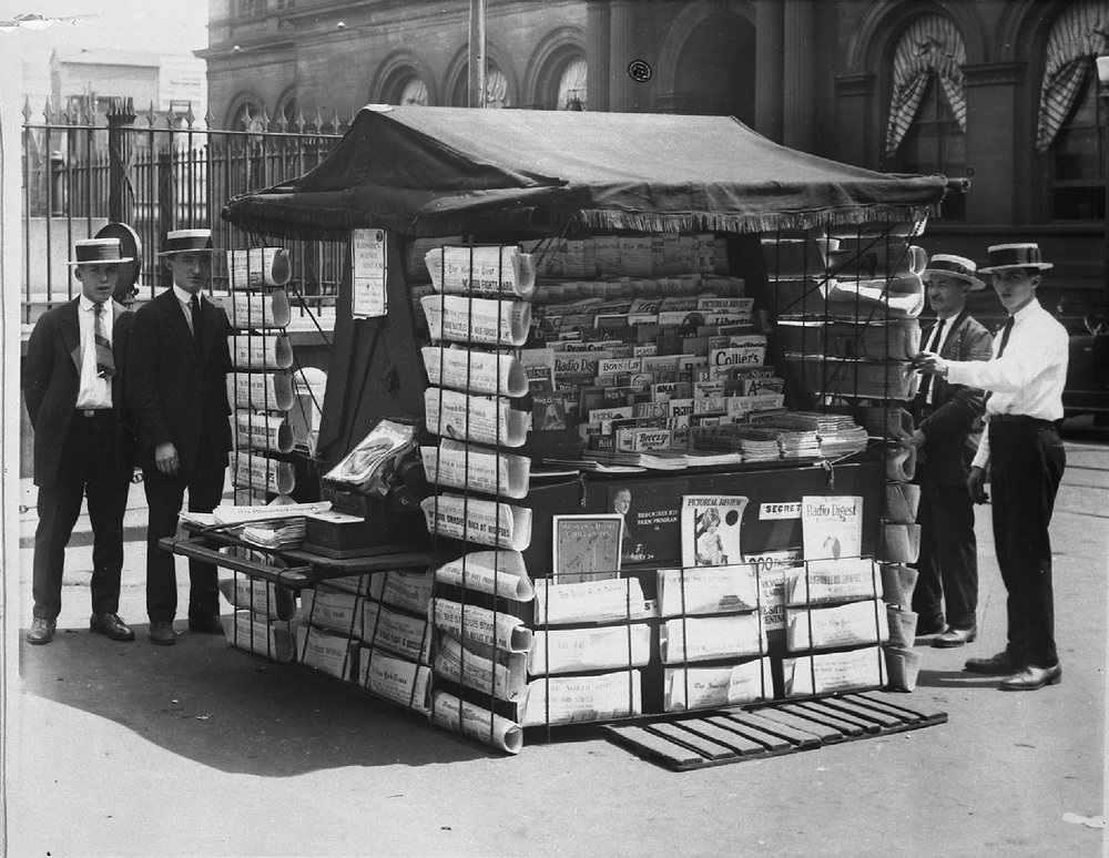 Abe Sherman, his father and two customers at his newsstand at the foot of the Battle Monument. Photo courtesy of the  Jewish Museum of Maryland  JMM 1988.165.1a