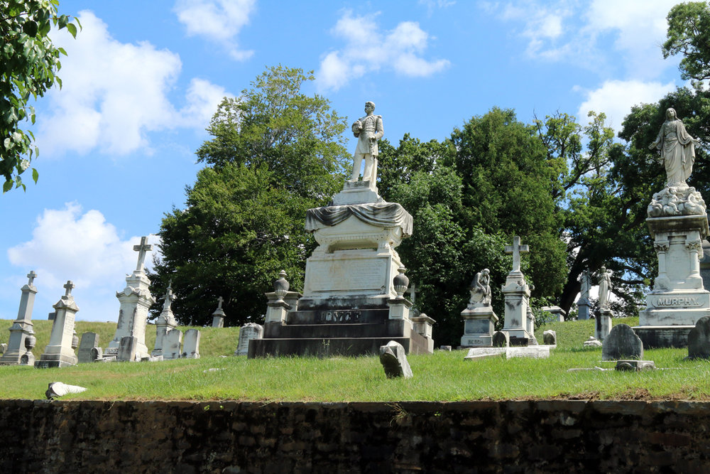 Col. Eugene Joyce seems to be forever looking over the view at New Cathedral Cemetery.