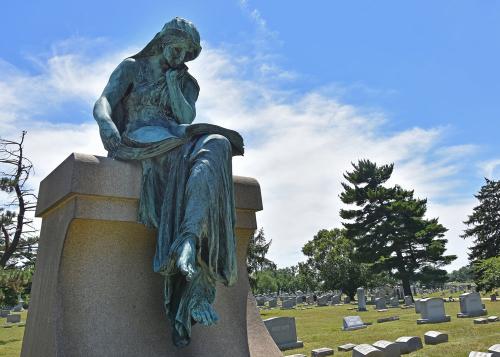 The Krug Family plot is located in Loudon Park Cemetery.  Hans Schuler,  a prolific Baltimore artist, created the thoughtful angel atop the grave.