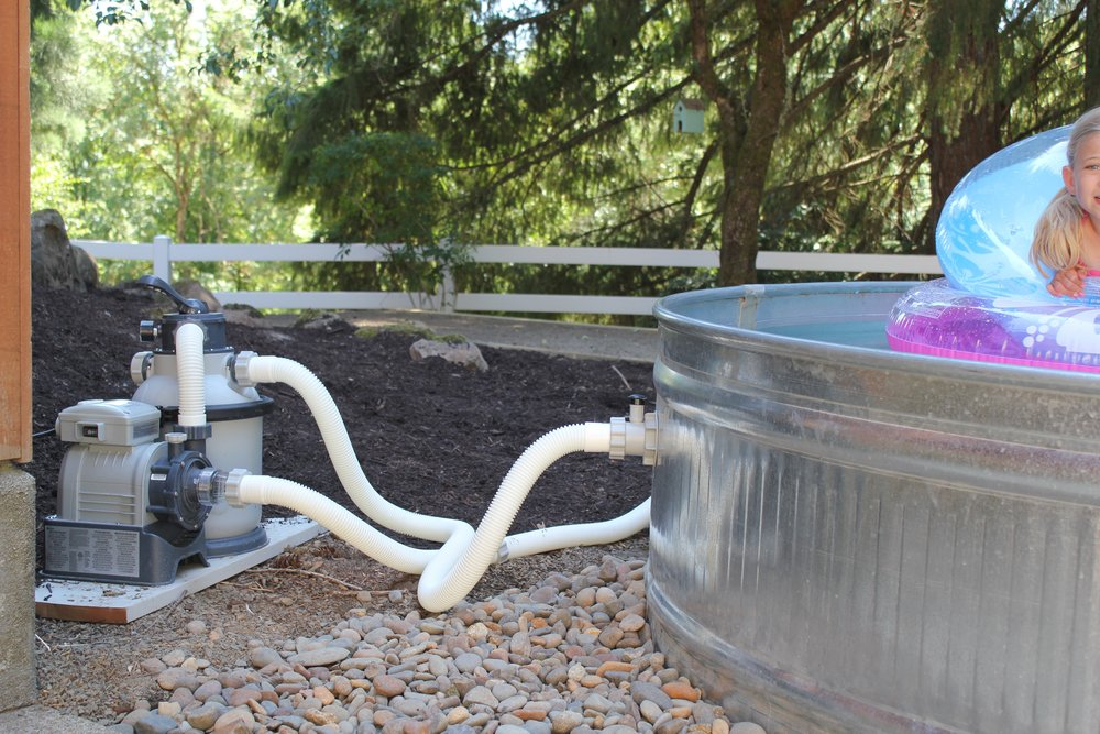 Stock tank pool our backyard pool md haney co - How to filter a stock tank swimming pool ...