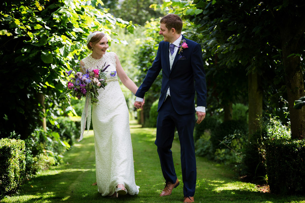 Couple in Garden at Dove Barn, Essex wedding