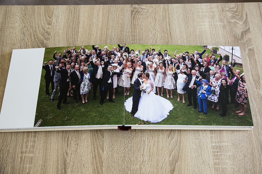 A sample two page spread in a Tom Needham Photography wedding album
