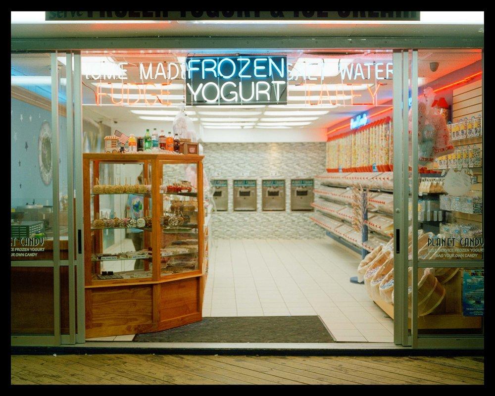 Frozen Yogurt, Seaside, NJ. 2015. Bronica ETRS.    A little salt water taffy, candy apples, and frozen yogurt stand late night on the boardwalk.