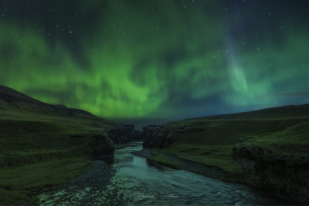 The Northern Lights (Aurora Borealis) over Fjaðrárgljúfur canyon.