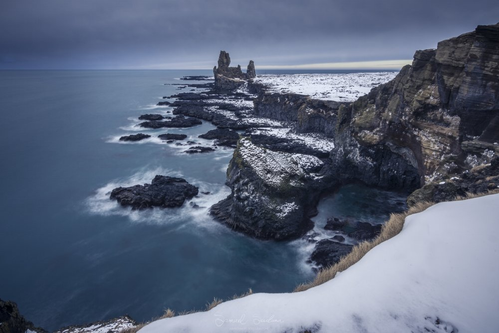 The epic Lóndrangar cliffs on the Snæfellsnes peninsula wearing their winter coat!
