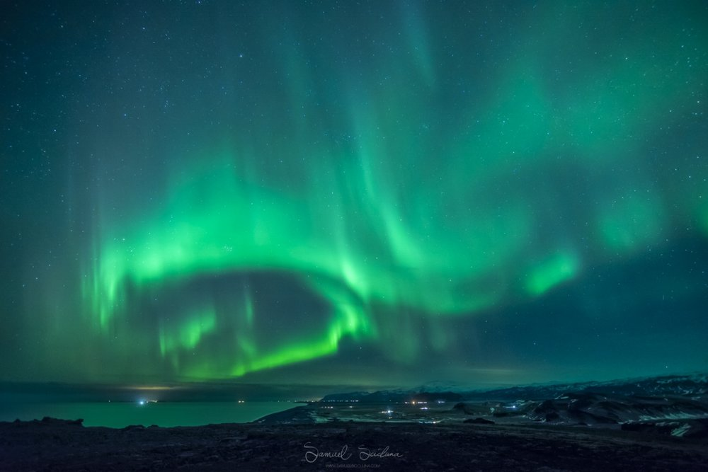 The Northern Lights above the coast in the South of Iceland.