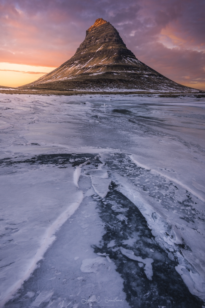 I found a cone shaped patch on the frozen lake and used this as a leading line, but also as it mirrors the shape of the mountain. The high clouds caught the light before sunset and helped make a great shot!