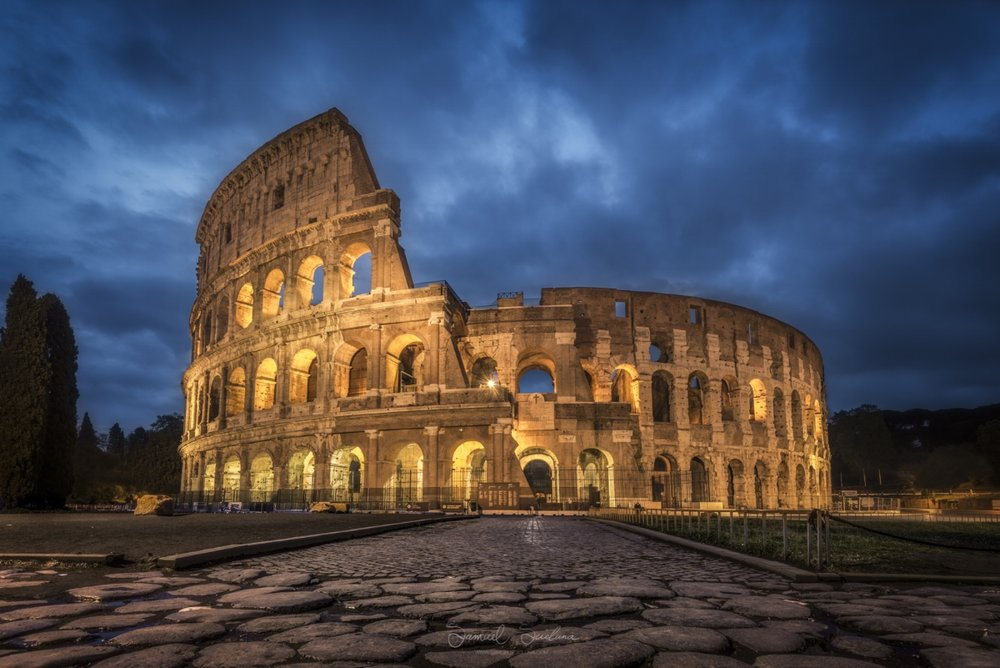 The Colosseum with moody rain clouds at Blue hour.