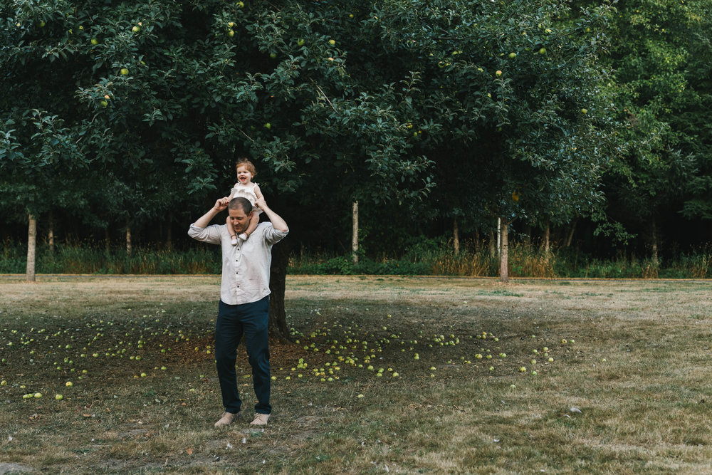Playful and sweet family session in Issaquah at golden hour and twilight Mom and Dad with their toddler photographed by Chelsea Macor Photography in a playful and intimate way-10.jpg