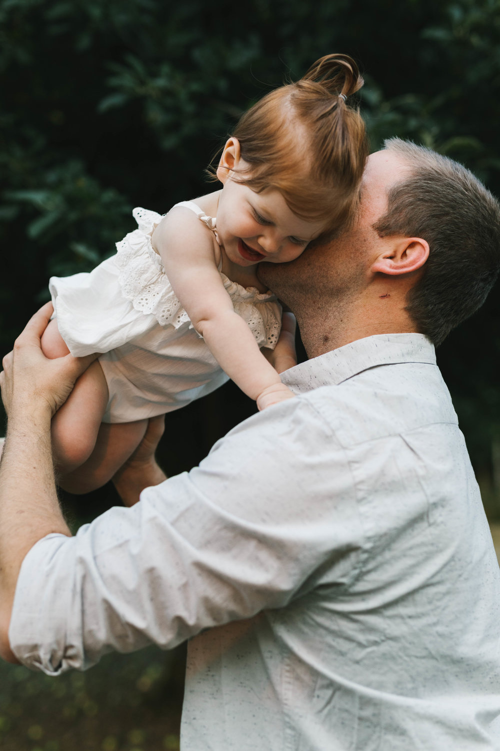 Playful and sweet family session in Issaquah at golden hour and twilight Mom and Dad with their toddler photographed by Chelsea Macor Photography in a playful and intimate way-12.jpg