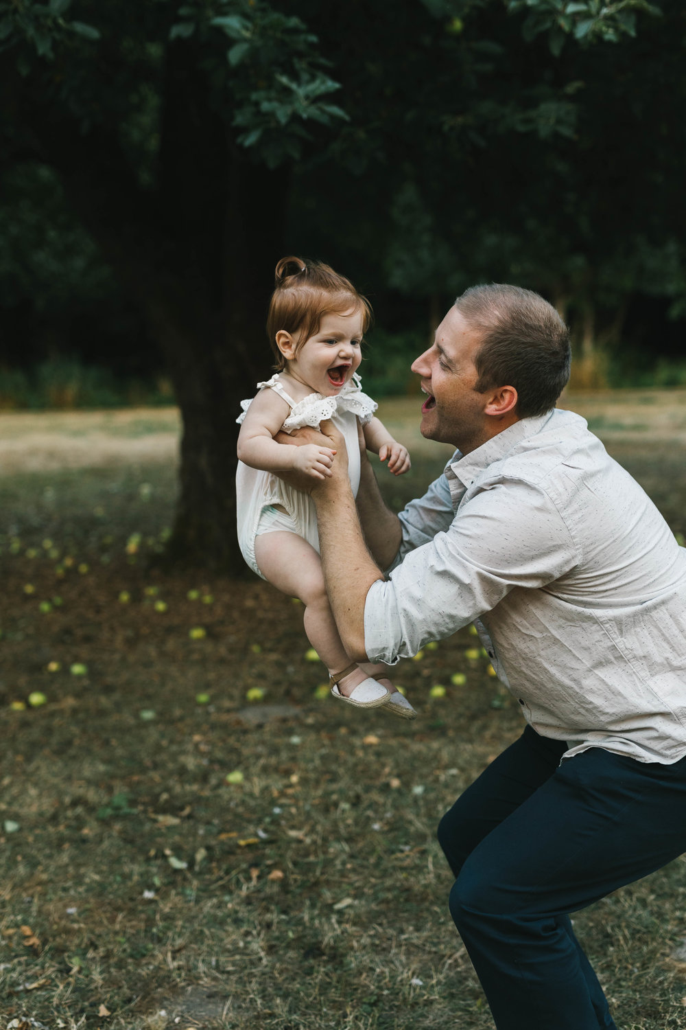 Playful and sweet family session in Issaquah at golden hour and twilight Mom and Dad with their toddler photographed by Chelsea Macor Photography in a playful and intimate way-17.jpg