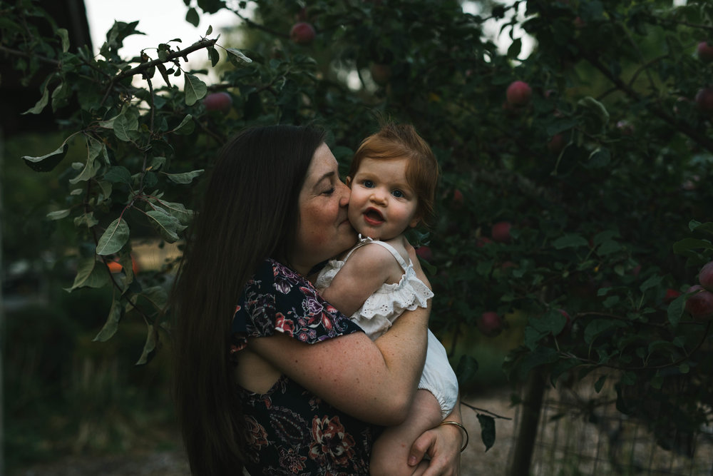 Playful and sweet family session in Issaquah at golden hour and twilight Mom and Dad with their toddler photographed by Chelsea Macor Photography in a playful and intimate way-19.jpg