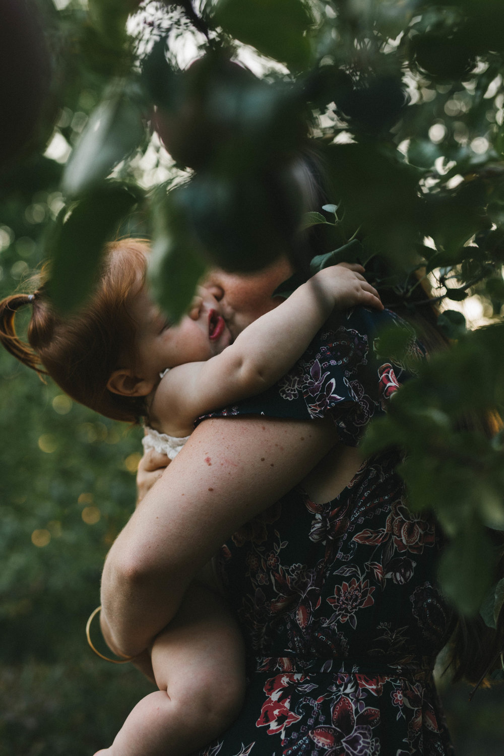 Playful and sweet family session in Issaquah at golden hour and twilight Mom and Dad with their toddler photographed by Chelsea Macor Photography in a playful and intimate way-21.jpg