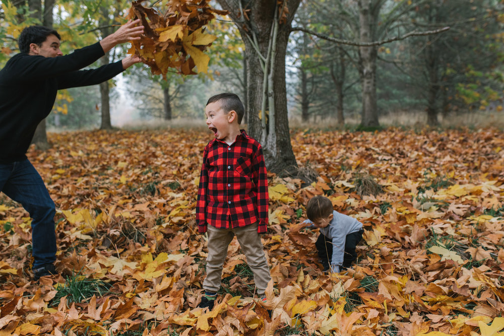 Leaf Throwing sweet Seattle Discovery Park Family Photo Session during golden hour by Chelsea Macor Photography-10.jpg
