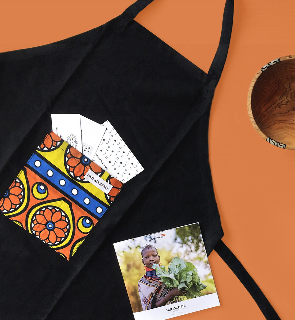 An apron designed by myself and handmade by  Ubuntu Made  was included in the Volume 4 boxes of Hunger Free Quarterly. Every apron used a different kanga pattern for the pocket, making each a unique gift.