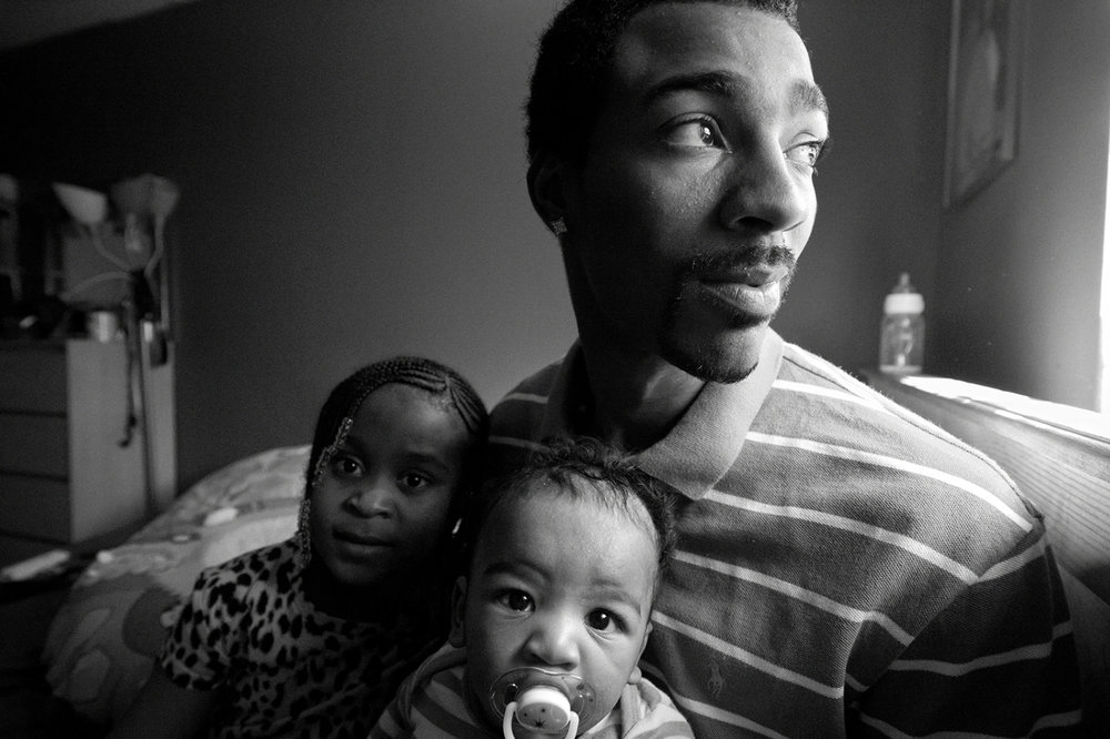 Zun Lee,  Guy Miller prepares for nap time with daughter Nijeyah and newborn Guy Jr.,  Bronx, NY, 2011